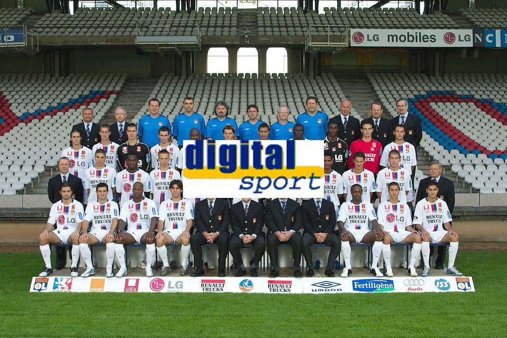 Equipe - Lyon - Photo Officielle -03.08.2005 - L1 - OL - Foot Football - largeur attitude pose<br /> <br /> <br /> <br /> 1er rang - assis de gauche a droite: <br /> BERTHOD - FRAU - WILTORD - JUNINHO - HOULLIER - AULAS - BERGUES entraineur adjoint)- GARDE - GOVOU - NILMAR - BEN ARFA<br /> 2 eme Rang de gauche a droite<br /> LACOMBE - BENZEMA - ESSIEN - PEDRETTI - DIARRA - CAREW - CRIS - MALOUDA - CLEMENT - VIALE - Jacky Gieu (president OL animation) - <br /> 3eme rang de gauche a droite<br /> TRUCHET - CLERC - VERCOUTRE - REVEILLERE - CACAPA - COUPET - MONSOREAU - DIATTA - HARTOCK - RIOU - GENET - <br /> 4eme rang de gauche a droite<br /> Christophe COMPARAT (vice president) - Gilbert GIORGI (vice president) - Patrick PERRET (kine-Osteopate DO) - Abdeljelil REDISSI (Kine-Osteopate DO) - Joel BATS (Entraineur des gardiens) - Robert DUVERNE (Preparateur physique) - Jean Jacques AMPRINO (medecin) - Guy GENET (Coordinateur Sportif) - Serge MANOUKIAN (vice president) - Jean Paul REVILLON (vice president) - Bernard MOYEN (vice president) -