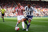 Charlie Adam of Stoke City and Joleon Lescott of West Bromwich Albion challenge for the ball. Barclays Premier League match, Stoke city v West Bromwich Albion at the Britannia stadium in Stoke on Trent, Staffs on Saturday 29th August 2015.<br /> pic by Chris Stading, Andrew Orchard sports photography.
