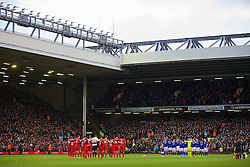 05.01.2014, Anfield, Liverpool, ENG, FA Cup, FC Liverpool vs FC Oldham Athletic, 3. Runde, im Bild Liverpool and Oldham Athletic players stand to remember Wayne Harrison // during the English FA Cup 3rd round match between Liverpool FC and Oldham Athletic FC at the Anfield in Liverpool, Great Britain on 2014/01/05. EXPA Pictures © 2014, PhotoCredit: EXPA/ Propagandaphoto/ David Rawcliffe<br /> <br /> *****ATTENTION - OUT of ENG, GBR*****