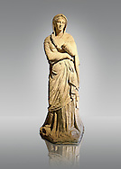 Greek Late Hellenistic marble statue of Baeria, from Magnesia AD Maeandrum ( Menderes Manisasi ), temple of Athens, Turkey. Mid 1st cent. B.C .  Istanbul Archaeological museum Inv 605 T.  Cat. Mendel 550 .<br /> <br /> If you prefer to buy from our ALAMY STOCK LIBRARY page at https://www.alamy.com/portfolio/paul-williams-funkystock/greco-roman-sculptures.html- Type -    Istanbul    - into LOWER SEARCH WITHIN GALLERY box - Refine search by adding a subject, place, background colour, museum etc.<br /> <br /> Visit our CLASSICAL WORLD HISTORIC SITES PHOTO COLLECTIONS for more photos to download or buy as wall art prints https://funkystock.photoshelter.com/gallery-collection/The-Romans-Art-Artefacts-Antiquities-Historic-Sites-Pictures-Images/C0000r2uLJJo9_s0c