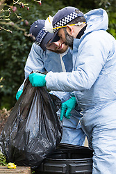 Police go through the contents of rubbish bins as they continue to investigate at the the house where the body of French film producer 34-year-old Laureline Garcia-Bertaux was found buried in a shallow grave at an address in Kew, London, after she was reported missing on Tuesday march 5th 2019. London, March 10 2019.