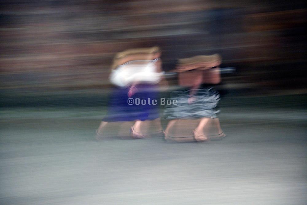 motion blur of two women walking