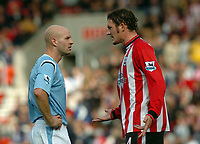 Fotball<br /> 2004/2005<br /> Foto: SBI/Digitalsport<br /> NORWAY ONLY<br /> <br /> The Barclays Premiership.<br /> <br /> Southampton v Manchester City<br /> 02.10.2004<br /> <br /> Danny Mills of City is confronted by Jelle Van Damme of Saints after playing on whilst Niemi is injured.