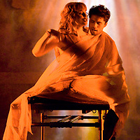 """Actress Jessica Lafever, playing the part of Mimi Márquez, and actor Brian Danglash, playing the part of Roger Davis, share an intimate moment on stage during a dress rehearsal for the Las Positas production of Rent at Las Positas College on March 29, 2010. Lafever and Danglash get close with a bed sheet during the musical number """"Contact,"""" with the sheet representing the two making love."""