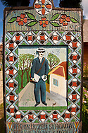 Tombstone of a clerk,  The  Merry Cemetery ( Cimitirul Vesel ),  Săpânţa, Maramares, Northern Transylvania, Romania.  The naive folk art style of the tombstones created by woodcarver  Stan Ioan Pătraş (1909 - 1977) who created in his lifetime over 700 colourfully painted wooden tombstones with small relief portrait carvings of the deceased or with scenes depicting them at work or play or surprisingly showing the violent accident that killed them. Each tombstone has an inscription about the person, sometimes a light hearted  limerick in Romanian. .<br /> <br /> Visit our ROMANIA HISTORIC PLACXES PHOTO COLLECTIONS for more photos to download or buy as wall art prints https://funkystock.photoshelter.com/gallery-collection/Pictures-Images-of-Romania-Photos-of-Romanian-Historic-Landmark-Sites/C00001TITiQwAdS8