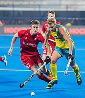 BHUBANESWAR, INDIA - Daniel Beale (Aus) with Liam Sanford (Eng) , England v Australia for the bronze medal during the Odisha World Cup Hockey for men  in the Kalinga Stadion.   COPYRIGHT KOEN SUYK