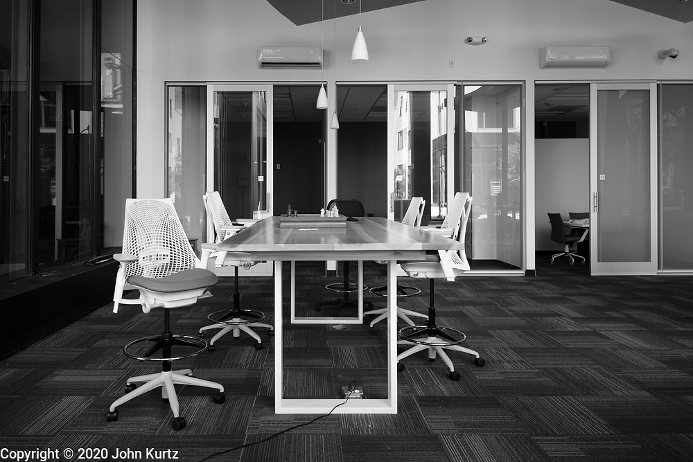 01 OCTOBER 2020 - DES MOINES, IOWA:  An empty co-working space in downtown Des Moines. The economy in downtown Des Moines is still feeling the affects of the COVID-19 shutdown ordered in March. Seven months after the shutdown, employers still have their workers working from home. Restaurants, barbershops, and retail are feeling the impact. Many have closed or cut back on workers and hours.       PHOTO BY JACK KURTZ