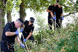 © Licensed to London News Pictures.16/07/2013. Soth Yardley, Birmingham, UK. The scene in Wash Lane, South Yardley, Birmingham, where a fifteen year old boy was stabbed at the entrance to the nearby park.Police search the nearby park.  Photo credit : Dave Warren/LNP