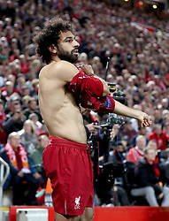 Liverpool's Mohamed Salah removes his undershirt