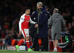 Arsenal's Alexis Sanchez walks by manager Arsene Wenger after being substituted during the UEFA Champions League Round of 16, Second Leg match at the Emirates Stadium, London.