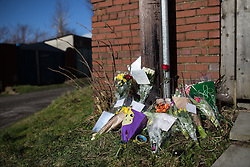 © Licensed to London News Pictures . 16/02/2014 . Oldham , UK . Flowers and tributes left behind terraces parallel to Ripponden Road after the body of fifteen year old Leon Cudworth was discovered in the early hours of 15th Februrary 2014 . Photo credit : Joel Goodman/LNP