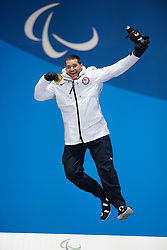 March 12, 2018 - Pyeongchang, South Korea - Gold medalist Mike Schultz of the US celebrates during a medal ceremony for Men's Snowboard Cross Monday, March 12, 2018 at the Medals Plaza for the 2018 Pyeongchang Winter Paralympic Games. Photo by Mark Reis (Credit Image: © Mark Reis via ZUMA Wire)