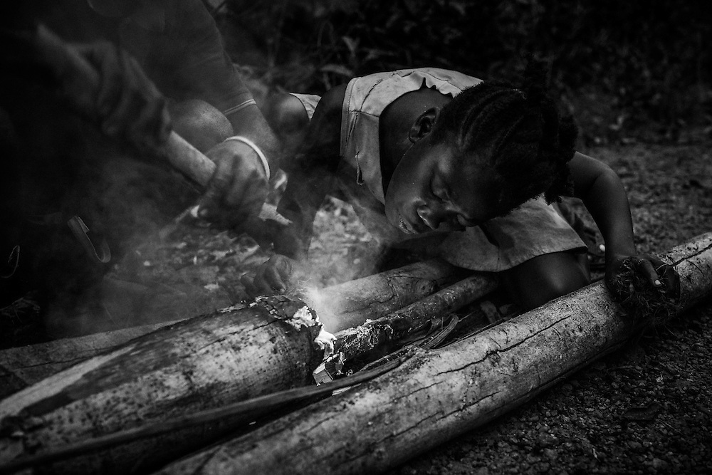 Girl helps us make fire and keep us company as we wait for rescue. John Logan Town, Liberia.