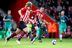 Southampton's Oriol Romeu (centre) tackles Tottenham Hotspur's Lucas Moura which results in him receiving a yellow card during the Premier League match at St Mary's Stadium, Southampton.