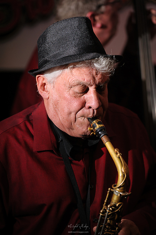 Alan Weber, Sr. working the sax, performing with Swing That Cat during the first live music event at Human Village Brewing Co.