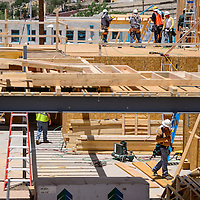 070314       Cable Hoover<br /> <br /> Construction workers erect the framing of the second story of the new Care 66 housing complex in downtown Gallup Thursday.