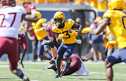 Sep 18, 2021; Morgantown, West Virginia, USA; West Virginia Mountaineers wide receiver Sam James (13) catches a pass and runs for a touchdown during the second quarter against the Virginia Tech Hokies at Mountaineer Field at Milan Puskar Stadium. Mandatory Credit: Ben Queen-USA TODAY Sports