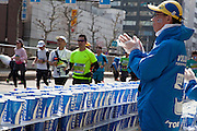 A refreshment stand staffed by volunteers near Tsukiji during the 10th Tokyo Marathon took place on a fine spring day in Tokyo Japan. Sunday February 28th 2016. Thirty-six thousand runners took part with Ethiopian,  Feyisa Lilesa winning the  men's competition and  Kenyan, Helah Kiprop victorious in the women's race.