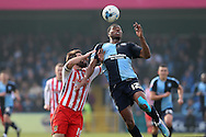 Rowan Liburd of Wycombe Wanderers jumps to head the ball over Dean Wells of Stevenage. Skybet football league two match, Wycombe Wanderers  v Stevenage Town at Adams Park  in High Wycombe, Buckinghamshire on Saturday 12th March 2016.<br /> pic by John Patrick Fletcher, Andrew Orchard sports photography.