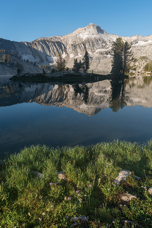 Peaks reflected in a subalpine lake, Wallowa Mountains, Oregon.