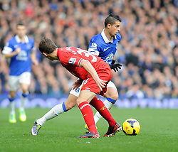 Everton's Kevin Mirallas passes Liverpool's Jon Flanagan - Photo mandatory by-line: Dougie Allward/JMP - Tel: Mobile: 07966 386802 23/11/2013 - SPORT - Football - Liverpool - Merseyside derby - Goodison Park - Everton v Liverpool - Barclays Premier League