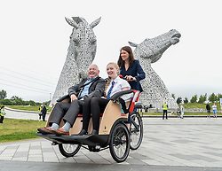 Pictured: Public health and sport minister Aileen Campbell pedals Norman Ridley (81) and Amelia Franchi (14) followed by other Cycling Without Age users.<br /> <br /> Public health and sport minister Aileen Campbell took to the saddle to launch the Scotland-wide rollout of the Cycling without Age service, designed to get older people out and about.<br /> <br /> © Dave Johnston / EEm