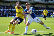 Danny Hylton  and Tom Lockyer battle during the Sky Bet League 2 match between Bristol Rovers and Oxford United at the Memorial Stadium, Bristol, England on 6 September 2015. Photo by Alan Franklin.