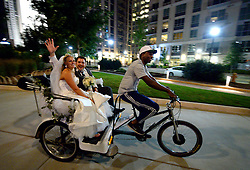 Newlyweds ride through Romare Bearden Park past protesters Saturday, September 24, 2016 in Charlotte, NC, USA. Protesters came together for the fifth straight night to protest following the fatal shooting of Keith Lamont Scott. Keith Lamont Scott was shot and killed by Charlotte-Mecklenburg Police Officer Brentley Vinson on Tuesday afternoon. Photo by Jeff Siner/Charlotte Observer/TNS/ABACAPRESS.COM