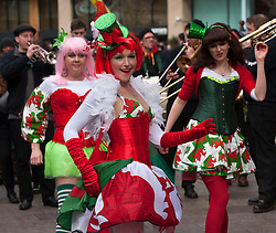 © Licensed to London News Pictures. 01/03/2014. Cardiff, Wales, UK.  Burlesque Cardiff  Glamorous Welsh-themed dancers perform in The Hayes. Thousands flock to Cardiff to watch the colourful St. David's Day parade - Dydd Gŵyl Dewi. The annual event is held historically on the feast day, 1st of March, in remembrance of the death of St. David (Dewi Sant) the patron saint of Wales. Tradition holds that he died on that day in 569 AD. Daffodils, a Welsh symbol or the leek, St. David's personal symbol, are worn by patriots. Photo credit : Graham M. Lawrence/LNP