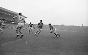 Roscommon in possession with a determined look which nearly brought results during the All Ireland Senior Gaelic Football Championship Final Kerry v Roscommon in Croke Park on the 23rd September 1962. Kerry 1-12 Roscommon 1-6.