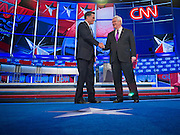 "22 FEBRUARY 2012 - MESA, AZ:    Governor MITT ROMNEY and Congressman NEWT GINGRICH shakes hands at the Arizona Republican Presidential Debate in the Mesa Arts Center in Mesa, AZ, Wednesday. It is the last debate before the Michigan and Arizona Republican primaries on Feb. 28 and ""Super Tuesday"" on March 6.        PHOTO BY JACK KURTZ"