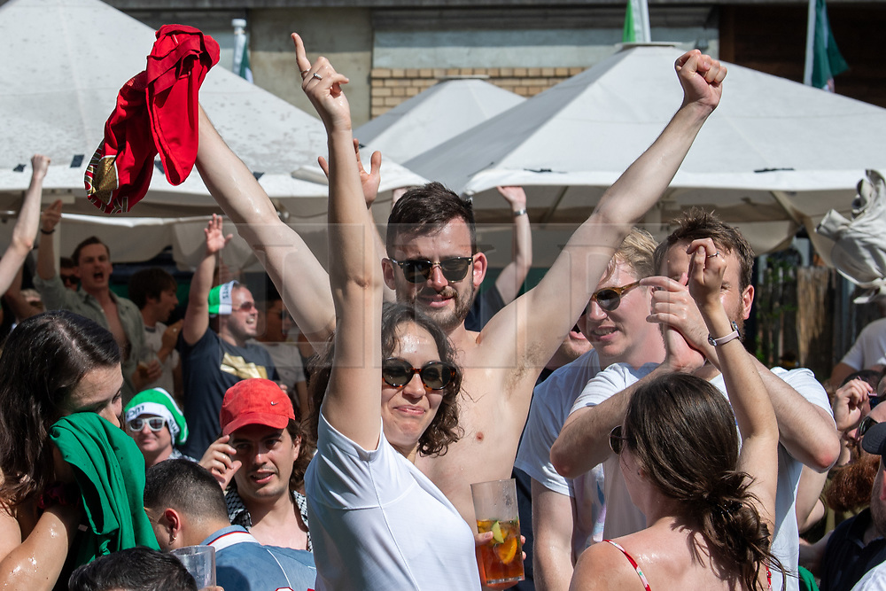© Licensed to London News Pictures. 13/06/2021. London, UK. Football fans celebrate an England win at Flat Iron Square in central London during the England v Croatia Euro 2020 Group D match played at Wembley Stadium. Photo credit: Peter Manning/LNP