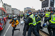 Police restrain a demonstrator during clashes following a 'Kill the Bill' protest in London on Saturday, April 3, 2021. The demonstration is against the contentious Police, Crime, Sentencing and Courts Bill, which is currently going through Parliament and would give police stronger powers to restrict protests. (Photo/ Vudi Xhymshiti)