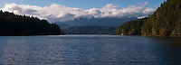 Dewatto Bay opening to the Hood Canal with the Olympic Mountains beyond, hiding their peaks in cloud, Kitsap Peninsula, Mason County, Puget Sound, Washington state, USA
