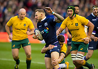 Rugby Union - 2017 Autumn Internationals - Scotland vs. Australia<br /> <br /> Bernard Foley tackles Byron McGuigan  at Murrayfield.<br /> <br /> COLORSPORT