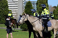MELBOURNE, VIC - SEPTEMBER 05: Police on horses are seen talking to a man during the Anti-Lockdown Protest on September 05, 2020 in Sydney, Australia. Stage 4 restrictions are in place from 6pm on Sunday 2 August for metropolitan Melbourne. This includes a curfew from 8pm to 5am every evening. During this time people are only allowed to leave their house for work, and essential health, care or safety reasons. (Photo by Dave Hewison/Speed Media)