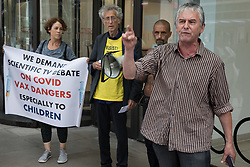 Heiko Khoo, seen here with Piers Corbyn, speaks outside the Labour Party headquarters following a protest lobby by supporters of left-wing Labour Party groups on 20th July 2021 in London, United Kingdom. He was refused permission to use the microphone by an organiser at the event, which coincided with a Labour Party National Executive Committee meeting to determine whether to proscribe four organisations: Resist, Labour Against the Witchhunt, Labour In Exile and Socialist Appeal.