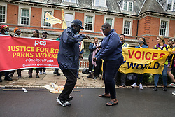 London, UK. 30th July, 2021. Royal Parks workers outsourced via French multinational VINCI Facilities dance on the picket line outside the Old Police House in Hyde Park during joint strike action by the United Voices of the World (UVW) and Public and Commercial Services (PCS) trade unions. The joint strike, with members dual carding over pay, conditions and the sacking of a member of staff, is believed to be the first between a TUC and a non-TUC trade union and follows the launch of a legal challenge by the Royal Parks workers against indirect racial discrimination by the Royal Parks.