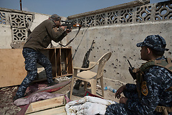 Licensed to London News Pictures. 02/04/2017. Mosul, Iraq. An Iraqi Federal Police marksman uses his rifle to search for an ISIS sniper in a position around 20 metres from the Islamic State front line.<br /> <br /> Iraqi forces continue to fight house to house as they push further into West Mosul. Iraqi forces are now advancing on the city's old districts where Islamic State fighters still hold out. Photo credit: Matt Cetti-Roberts/LNP