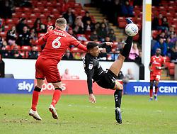 Walsall's Zeli Ismail attempts a tackle as Barnsley's Alex Mowatt attempts an overhead kick.
