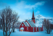 Flakstad Church (Norwegian: Flakstad kirke) is a parish church of the Church of Norway in Flakstad Municipality in Nordland county, Norway. It is located in the village of Flakstad. It is the church for the Flakstad parish which is part of the Lofoten prosti (deanery) in the Diocese of Sør-Hålogaland. The red, wooden church was built in a cruciform style in 1780. The church seats about 300 people. It is the millennium site for Flakstad Municipality.<br /> <br /> The long, low church building is a cog-jointed construction using timbers clad externally with red-painted wooden paneling, as was usual at the end of the eighteenth century. The small-paned windows have white frames. The roof is covered with tiles and a ridge turret with an onion dome and spire crowns the intersection of the cross arms.