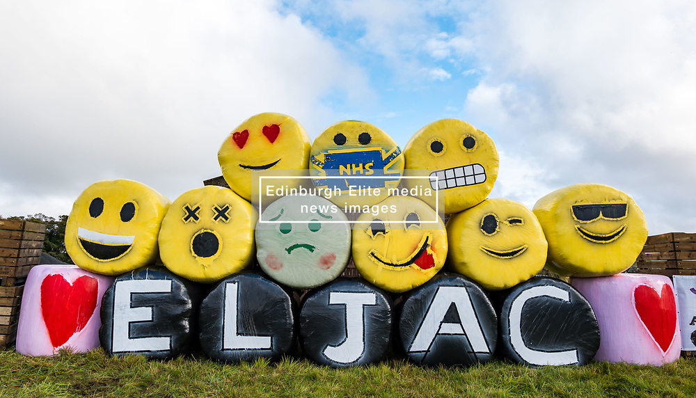 Athelstaneford, East Lothian, Scotland, United Kingdom, Bale Art 2020: <br /> East Lothian Junior Agricultural Club's bale art in support of charity RSABI, which supports people from Scottish agriculture emotionally, practically and financially. The yellow bale material was also bought in support of a children's cancer research charity. The theme this year is #keeptalking. <br /> Sally Anderson | EdinburghElitemedia.co.uk