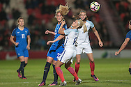 Kheira Hamraoui (France) wins the header against Rachel Daly (England) during the International Friendly match between England Women and France Women at the Keepmoat Stadium, Doncaster, England on 21 October 2016. Photo by Mark P Doherty.