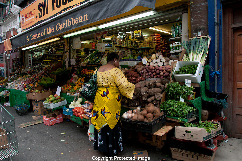 Brixton Market shops and stalls with multicultural fruit and veg