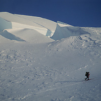 A mountaineer skis past seracs and crevasses on the icecap atop Chile's weather-beaten Cordillera Sarmiento, a previously unexplored range.