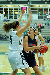 06 December 2017:  Hannah Frazier works close against Riley Brovelli during an NCAA women's basketball game between the Wheaton Thunder and the Illinois Wesleyan Titans in Shirk Center, Bloomington IL
