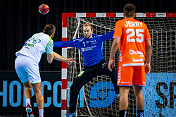 The Dutch handball player Bart Ravensbergen in action against Dragan Gajic from Slovenia during the European Championship qualifying match on January 6, 2020 in Topsportcentrum Almere