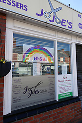NHS thank you poster in window of hairdresser during Coronavirus lockdown, Reading UK May 2020