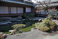 """Chiran Bukeyashiki Samurai Residence and Gardens - visitors can step into each of the seven gardens of which six are """"Karesansui"""" rock garden, and one a """"Chisen Kaiyu Shiki"""" strolling pond garden. Each garden features a miniaturized version of natural landscape, by wisely incorporating actual hillsides in the backdrop as part of the garden elements.  There are also landscaped alleys connecting the samurai residences and gardens called the  """"Honbaba promenade"""""""