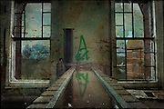Channel of water inside Hellingly Asylum http://www.vivecakohphotography.co.uk/2011/02/07/stygian-echoes/